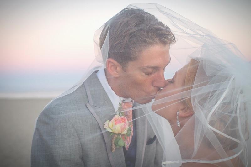 santa barbara beach wedding kiss