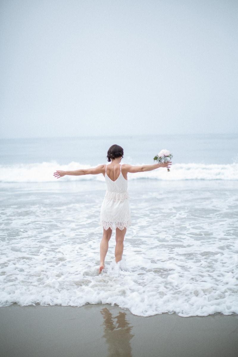 Soft focus, fine art image of a bride on during her Summerland elopement.