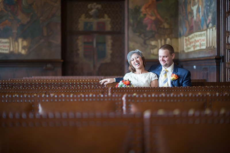 Candid laugh from newly weds at santa barbara courthouse