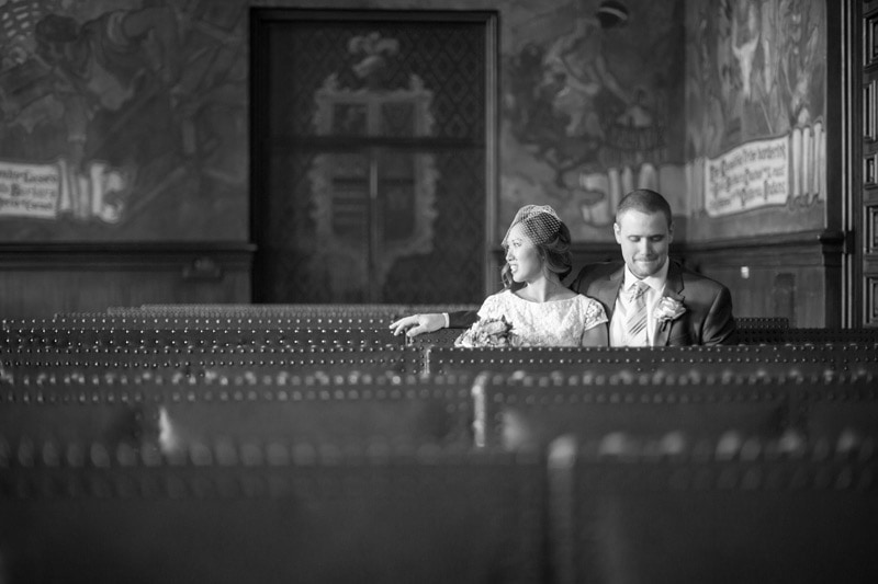 black and white candid of newly weds in mural room at Santa Barbara courthouse