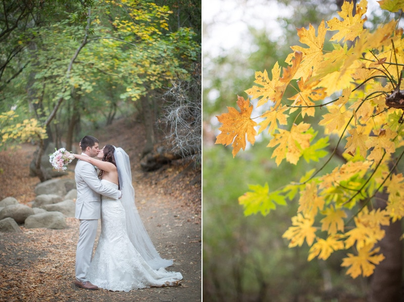 Beautiful fall colors surround these newly weds as they kiss on the path towards Nojoqui Falls in Solvang.