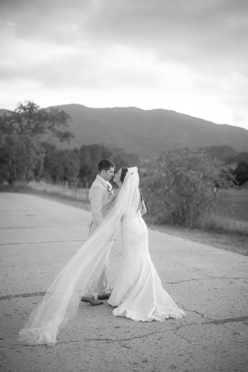 Intimate black and white image of newly weds after their Nojoqui Falls Elopement in Solvang.
