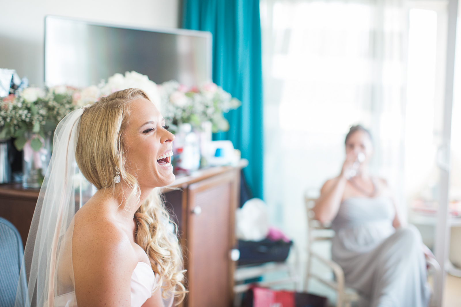 Candid, fun moment with bride during bridal prep at Hotel Milo before her wedding