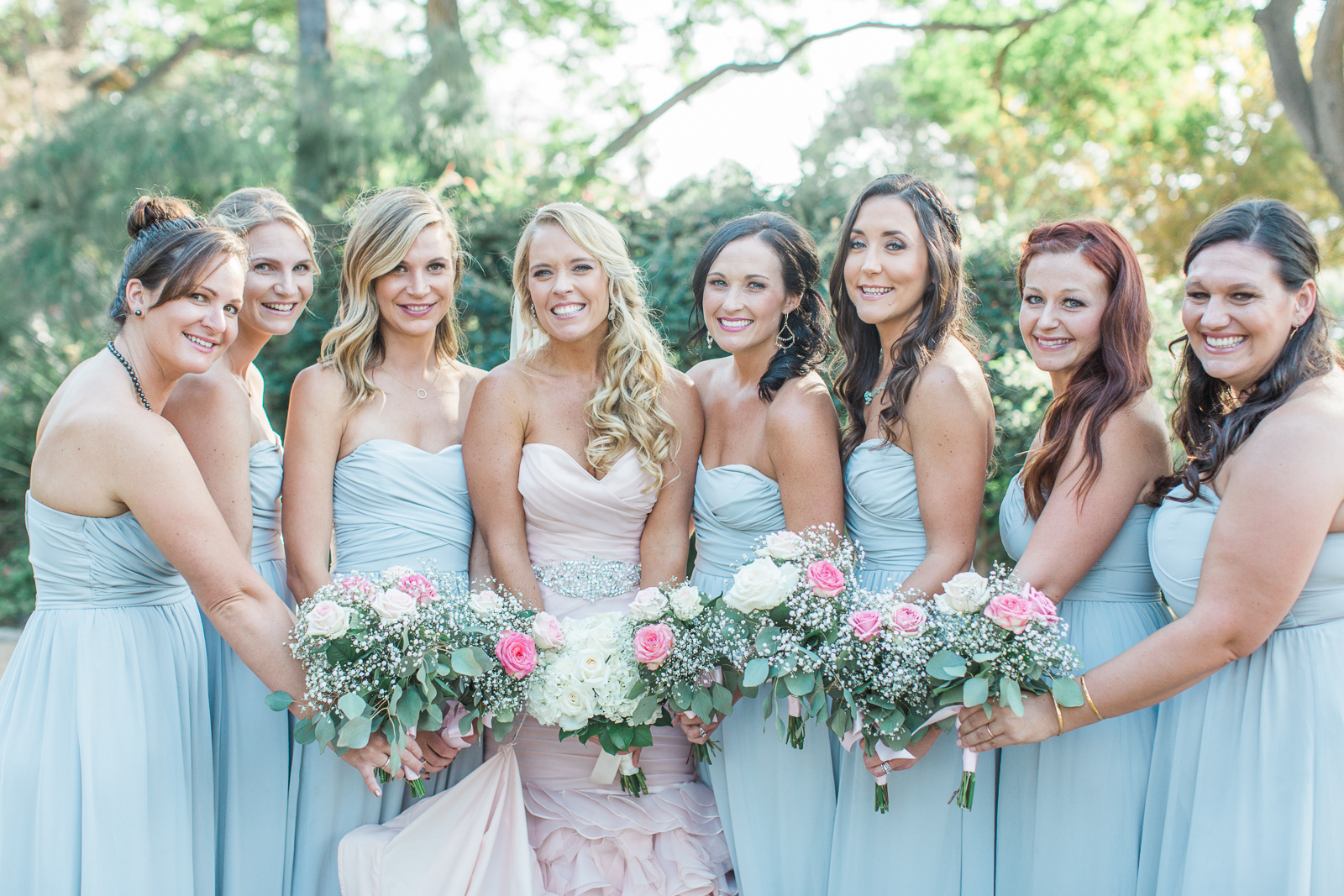 Bride, bridesmaids and bouquets of roses at Alice Keck Park Wedding