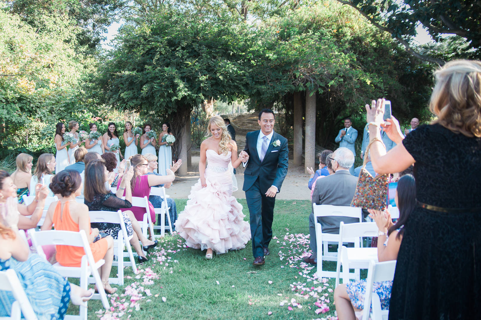 Bride and Groom walking down the aisle at Alice Keck Park