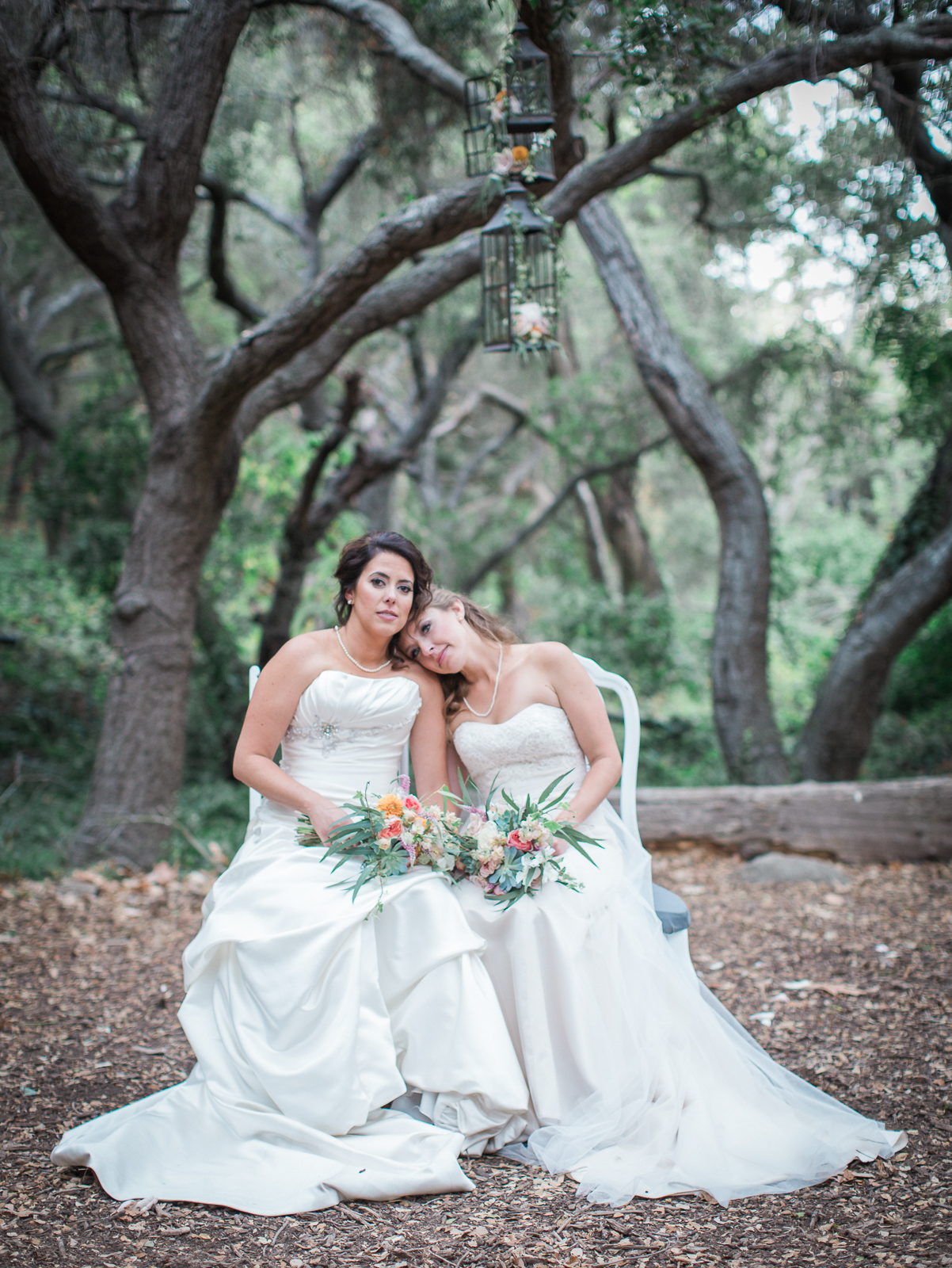 Beautiful bridal portrait of two brides at their Natural History Museum Wedding.
