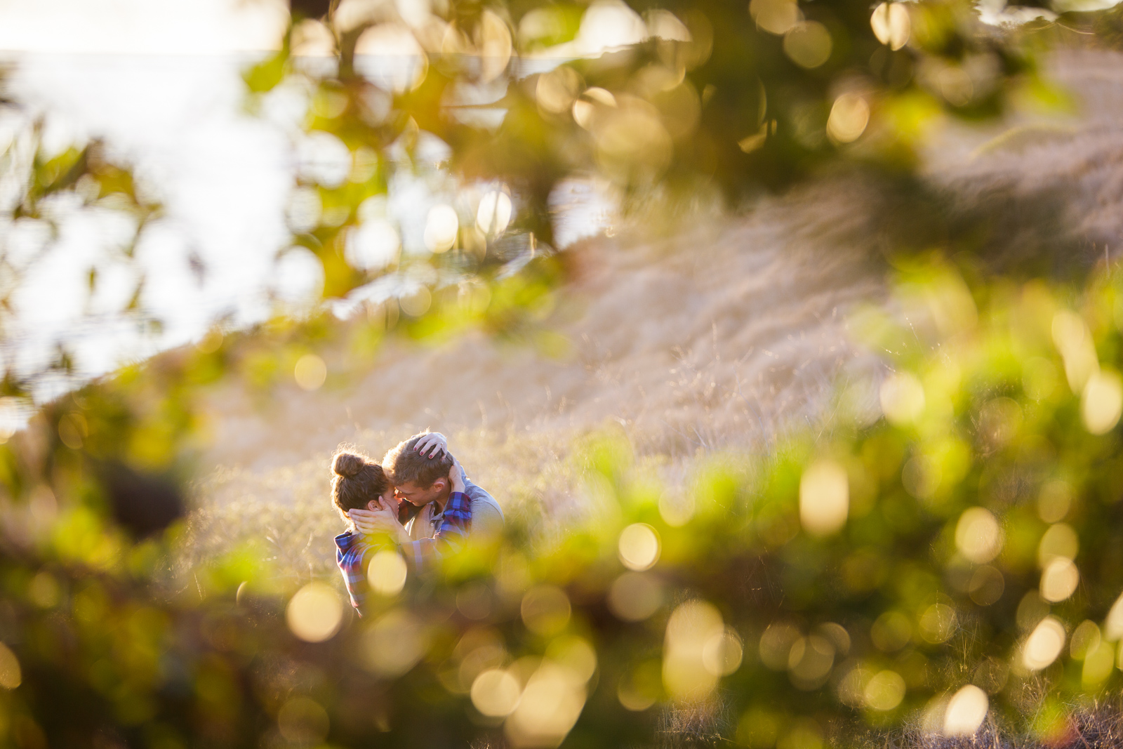 Passionate California coast engagement at sunset on the Gaviota Bluffs