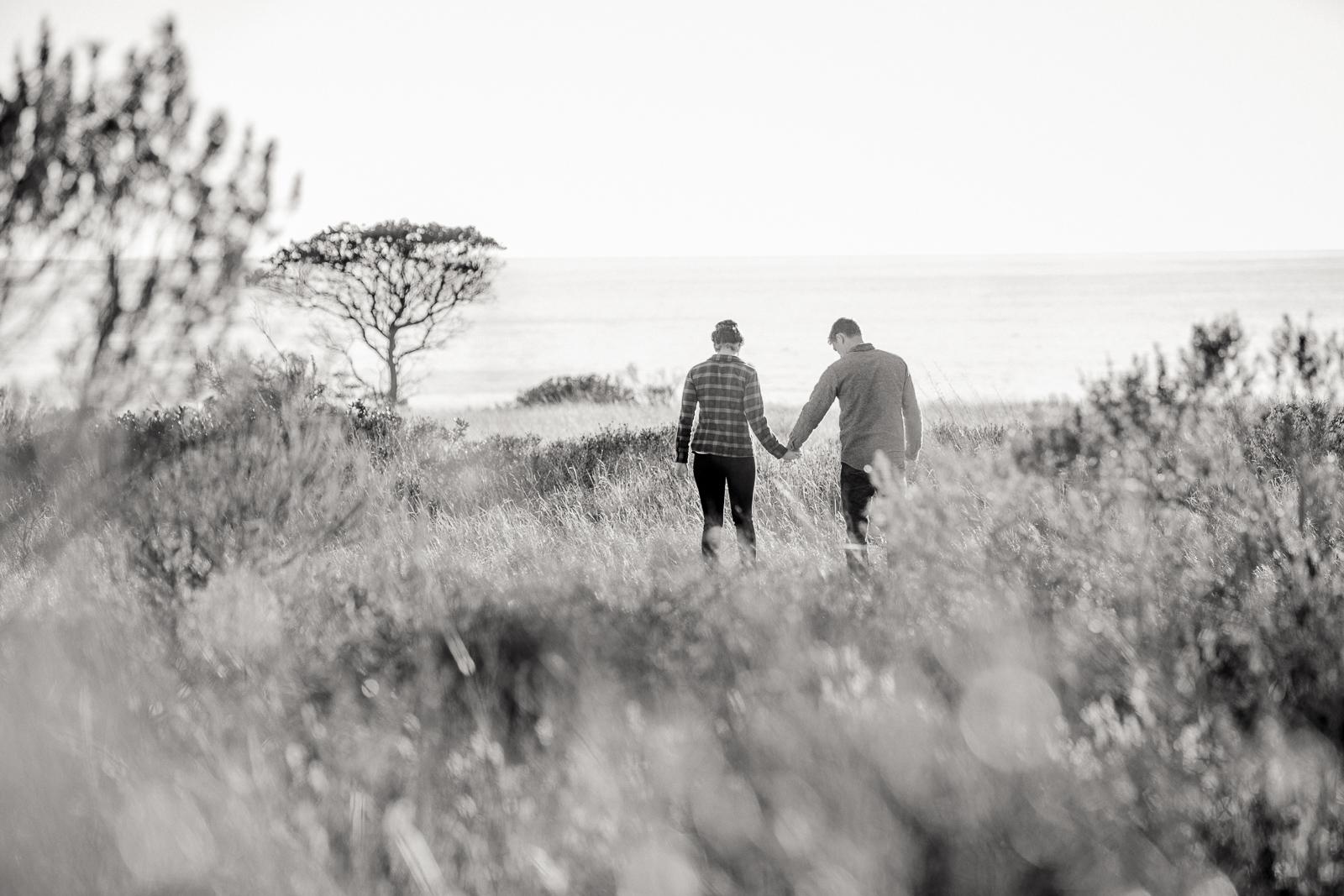 Black and white California coast engagement on the Gaviota Bluffs