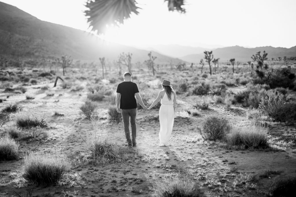 Sharp black and white stroll - into the sunset at Joshua Tree