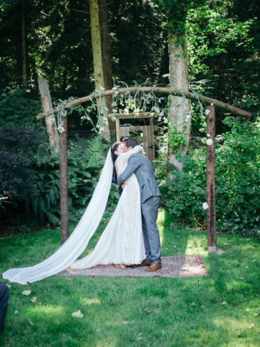Garden Wedding in Port Townsend | Bride and Groom kiss in the rainforests of the Pacific Northwest