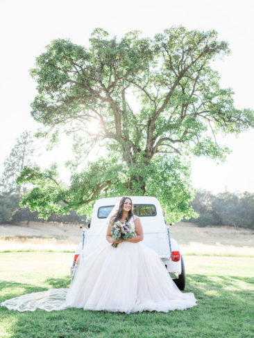 Murphys Ranch Wedding | Bride in the back of white vintage Ford truck
