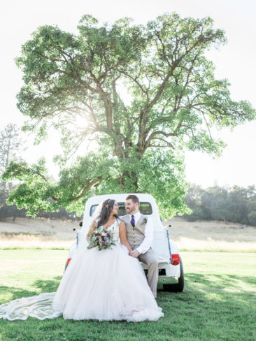 Murphys Ranch Wedding | Bride and Groom in the back of white vintage Ford truck