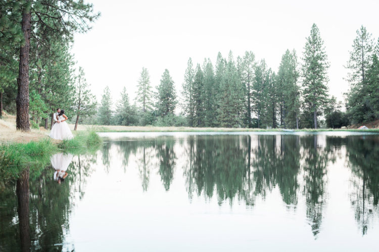 Murphys Ranch Wedding | Bride and Grooms Reflection in Pond with Pine Trees